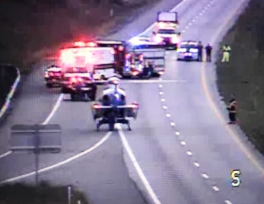 An image taken from a Virginia Department of Transportation camera shows a helicopter landing Sept. 22 in Augusta County on Interstate 81.