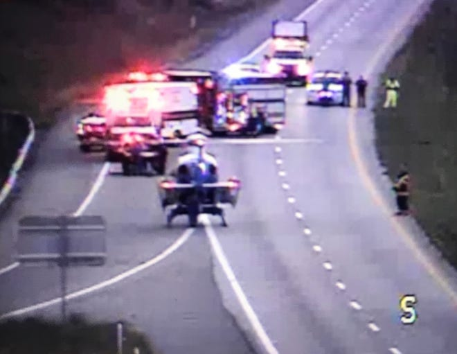 An image taken from a Virginia Department of Transportation camera shows a helicopter landing Sunday evening in Augusta County on Interstate 81.