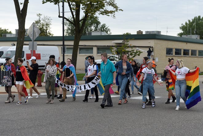 Students with the College of St. Benedict and St. John's University PRiSM walk during the first St. Cloud Pride Parade Sunday afternoon, Sept. 22, 2019, near downtown St. Cloud.