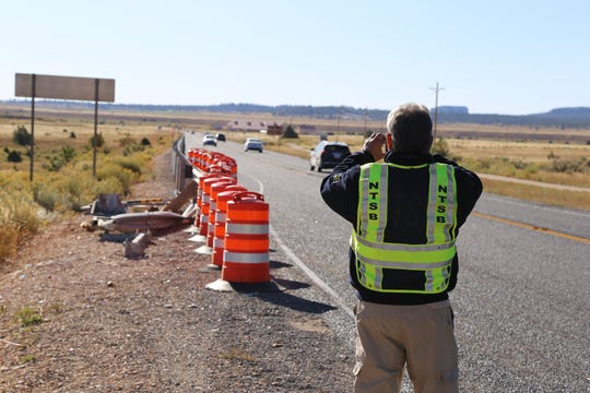 Ron Kaminski, an investigator with the National Transportation Safety Bureau, works near the site where a tour bus crash killed four Chinese tourists and injured more than a dozen others on Friday, Sept. 20, 2019.