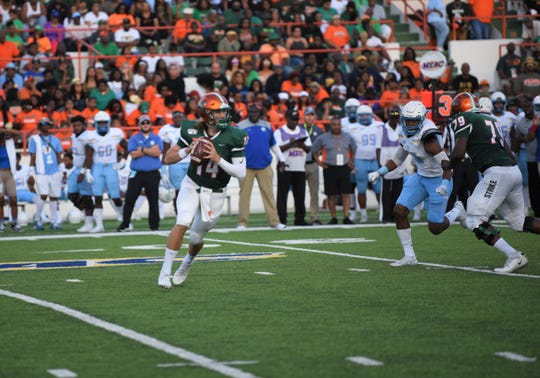 FAMU quarterback Ryan Stanley rolls out for a pass versus Southern.