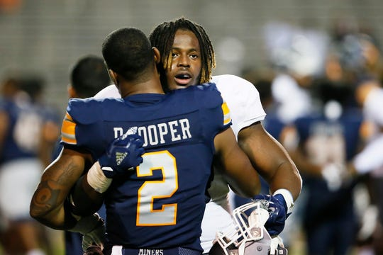 UTEP's Devaughn Cooper and Nevada's Lawson Hall share a few words after the game Saturday, Sept. 21, at the Sun Bowl in El Paso. Nevada won 37-21 against UTEP.