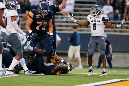 Nevada's  Tyson Williams (6) throws his hands up as UTEP's Treyvon Hughes goes into the end zone for a touchdown against Nevada Saturday, Sept. 21, at the Sun Bowl in El Paso.