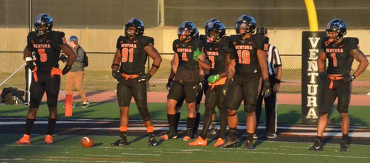 The Ventura College defense prepares for another snap against visiting Hancock on Saturday night at the VC Sportsplex. No. 5 VC prevailed, 35-14.