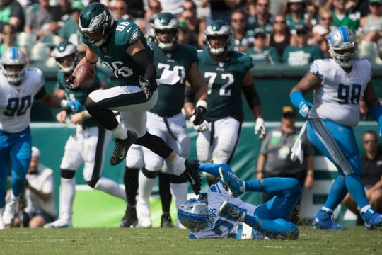 Eagles' Zach Ertz (86) hurdles Detroit's Quadre Diggs (28) Sunday at Lincoln Financial Field. The Lions defeated the Eagles 27-24.