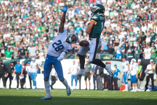 Eagles' J.J. Arcega-Whiteside (19) drops pass while under pressure from Detroit's Rashaan Melvin (29) Sunday, Sept. 22 at Lincoln Financial Field. The Lions defeated the Eagles 27-24.