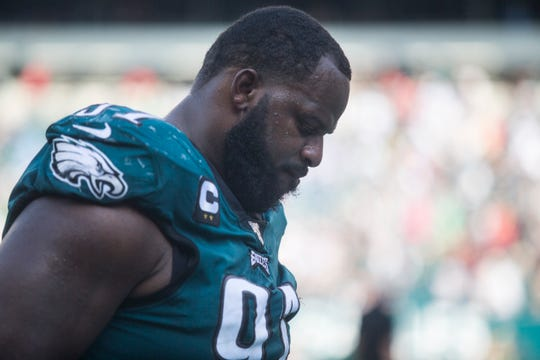Eagles' Fletcher Cox hangs his head as he leaves the field after a 27-24 loss to the Detroit Lions on Sunday, Sept. 22.
