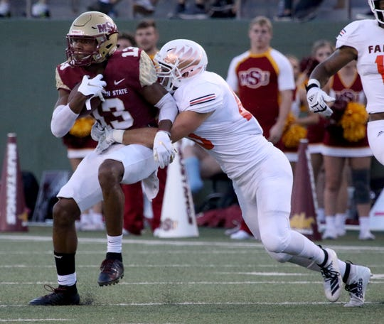 Midwestern State's Xavier Land is tackled by UT Permian Basin's Chris Hoad on Saturday, Sept. 21, 2019, at Memorial Stadium in Wichita Falls.