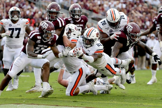 Auburn running back JaTarvious Whitlow (28) dives over the goal line for a touchdown against Texas A&M on Saturday, Sept. 21, 2019, in College Station, Texas.