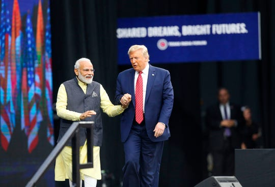 India Prime Minister Narendra Modi and US President Donald Trump walk hand in hand as they exit the stage at the Community Summit on September 22, 2019 at NRG Stadium  Houston, Texas.