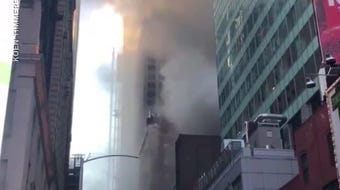 Authorities cordoned off streets near Times Square on September 22, after a fire in a nearby building threw plumes of smoke into the air.