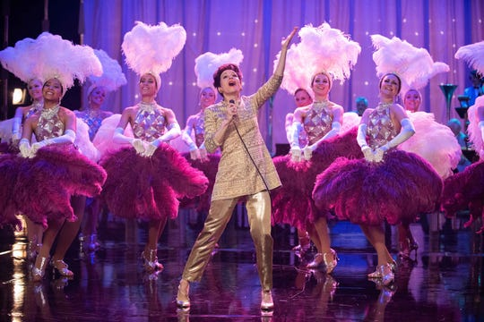 "Judy Garland (Renee Zellweger) is a showstopper with colorful backup dancers in ""Judy."""