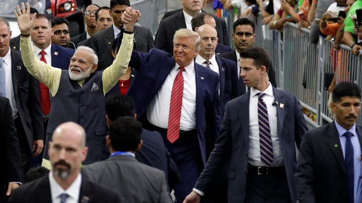 """President Donald Trump and Indian Prime Minister Narendra Modi walk around NRG Stadium waving to the crowd during the """"Howdy Modi: Shared Dreams, Bright Futures"""" event, Sunday, Sept. 22, 2019, in Houston."""