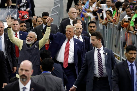 "President Donald Trump and Indian Prime Minister Narendra Modi walk around NRG Stadium waving to the crowd during the ""Howdy Modi: Shared Dreams, Bright Futures"" event, Sunday, Sept. 22, 2019, in Houston."