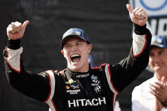 IndyCar driver Josef Newgarden celebrates after winning the NTT Indycar Series Championship during the WeatherTech Raceway Laguna Seca in Salinas, Calif.