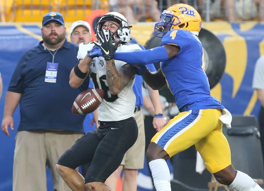 Central Florida receiver Tre Nixon (16) drops a pass under pressure from Pittsburgh defender Therran Coleman (4).