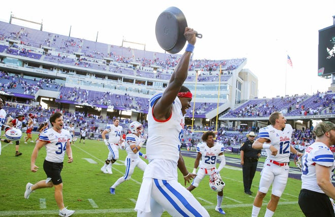 Southern Methodist Mustangs quarterback William Brown celebrates with the Iron Skillet after the victory against the TCU Horned Frogs at Amon G. Carter Stadium.