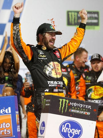 Martin Truex Jr. celebrates in victory lane.