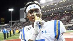 UCLA defensive back Mo Osling III celebrates after the Bruins beat Washington State 67-63.