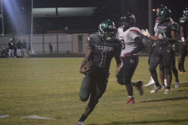 Peabody running back Arthur Lavalais (1) rushed for three touchdowns in the Warhorses' 30-12 victory over Northside Saturday.