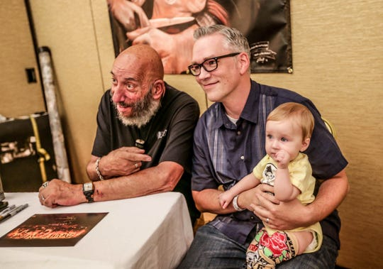 """Actor Sid Haig, left, from """"House of 1000 Corpses"""" and """"The Devil's Rejects,"""" poses for photos with Warren and Amelia Fisher at Days of the Dead Indy, June 26th, 2015."""