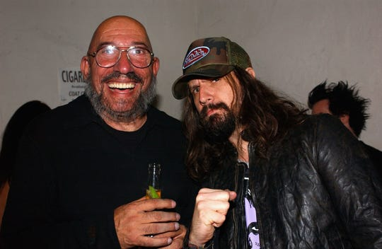 """Writer/director Rob Zombie, right, poses with actor Sid Haig at the Lionsgate Home Entertainment DVD release party of """"House of 1000 Corpses"""" at Club A.D. on Aug. 6, 2003 in Hollywood, California."""