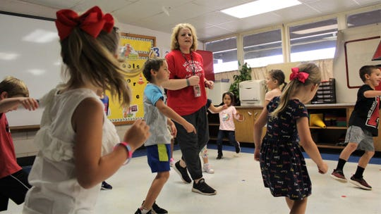 Teacher Marsha Hamilton encourages her energetic students at Austin Elementary School in exercise that includes some boogie to a 1970 hits by Earth, Wind & Fire. September 2019