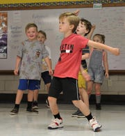 Wells Robinson gets into the swing of things during an exercise period at Austin Elementary School. Classrooms are being used this school year because the gym was torn down to build new buildings. September 2019