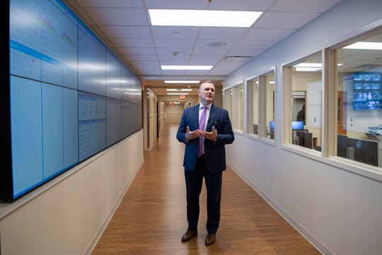 Mission Hospital CEO Chad Patrick talks about the GE wall of analytics in the interventional platform of the new North Tower at Mission Hospital during a media tour on Sept. 23, 2019. The screens allow staff to move patients around the hospital for procedures more efficiently.