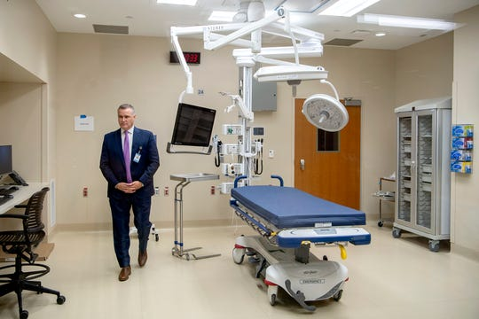 Chad Patrick, CEO of Mission Hospital, talks about the trauma bays in the emergency department of the new North Tower at Mission Hospital during a media tour on Sept. 23, 2019.