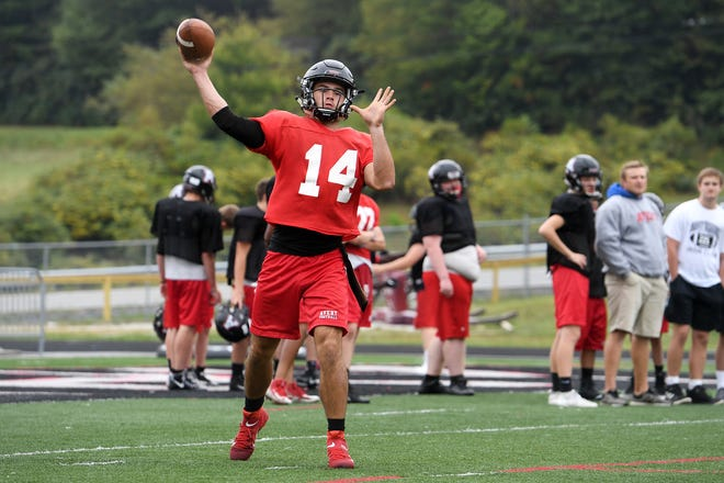 Avery County junior quarterback Troy Hoilman throws a pass during practice at Avery County High School in Newland on Sept. 18, 2019.
