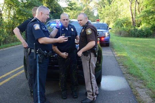 Officers view video of the fleeing suspects during the search.