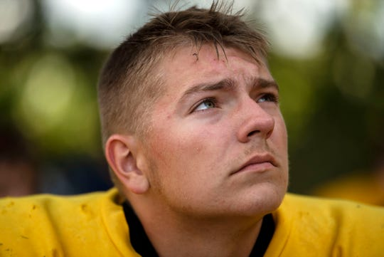 Climax-Scotts senior Blake Borden listens to head coach Kevin Langs during football practice on Monday, Sept. 23, 2019 in Climax, Mich. Borden was born with severe clubfoot, a condition in which his feet were twisted down and inward.