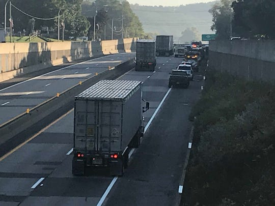 A tractor trailer carrying hazardous materials crashed on Interstate 88 around 1 a.m. Monday, Sept. 23. Traffic is seen backed up just south of the crash.
