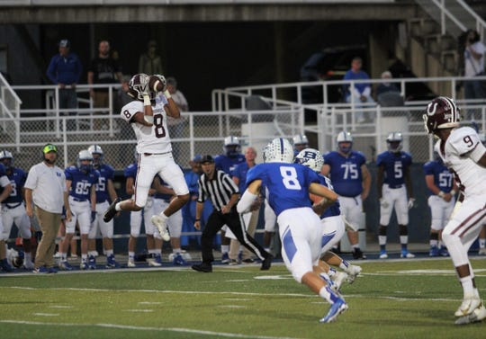 Owen senior Fred Graves hauls in one of his two receptions in a 20-0 Warhorse loss to Brevard on Sept. 20.