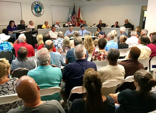 A crowd packed the Malabar Town Council meeting Monday night during the Yellow Dog Cafe zoning discussion.