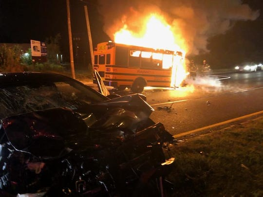 A stolen bus burns following a collision with a car (in the foreground)  in Pennsauken. Police are still searching for the bus driver, who escaped on foot, while the car driver suffered only minor injuries, according to the police chief.