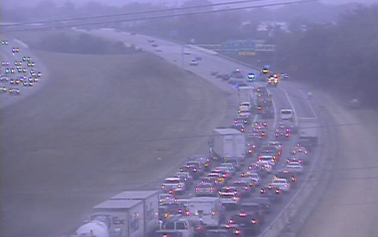 Vehicles are squeezing past an accident in one lane on SB I-75 between Union Centre and I-275 on Monday morning