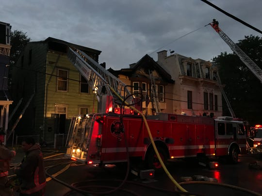 Fire crews Monday morning put out hot spots at a blaze that spread to five buildings in the CUF neighborhood