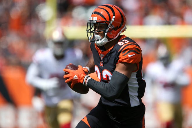 Cincinnati Bengals wide receiver Tyler Boyd (83) runs downfield after completing a reception in the first quarter of a Week 2 NFL football game against the San Francisco 49ers, Sunday, Sept. 15, 2019, at Paul Brown Stadium in Cincinnati.