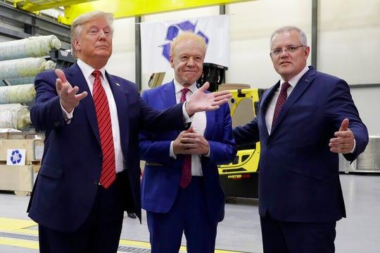 President Donald Trump and Australian Prime Minister Scott Morrison speak as Pratt Industries chairman Anthony Pratt, center, watches during a tour of Pratt Industries, Sunday, Sept 22, 2019, in Wapakoneta, Ohio. (AP Photo/Evan Vucci)
