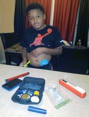 Trevon Garrett, 10, self-administers a daily dose of insulin.