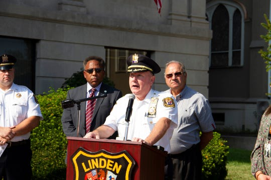Linden Police Chief David Hart speaks during a pedestrian safety program kicked off Monday outside City Hall.