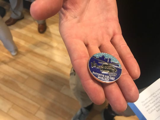 A Life Flight member gave this coin to Mark Block, whose life was saved by the program in 1986. The coin brought back memories of the nearly fatal crash, prompting Block to attend their 40th anniversary event and thank the flight nurse who saved him that night.