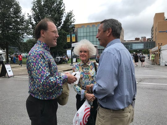 Mark Sanford talks with Jeanne Dietrich, 73, and her son Brian Dietrich, 41, who drove to Des Moines from Omaha on Sunday to meet him.