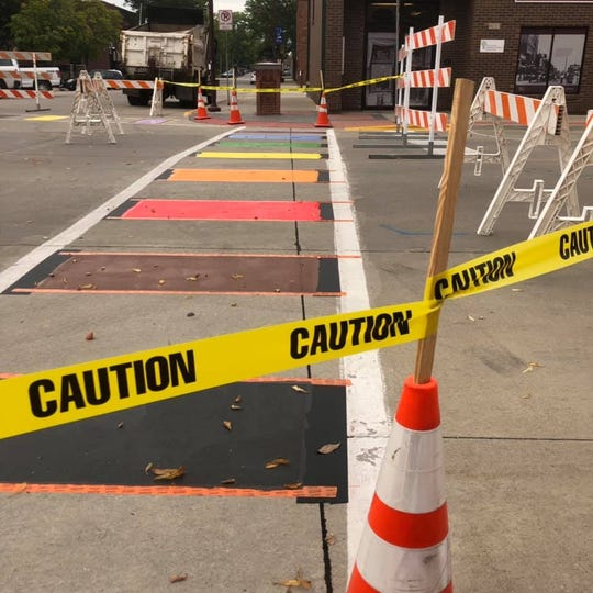 A freshly painted crosswalk sits at the intersection of 5th Street and Douglas Avenue in Ames Tues. Sept. 3. Ames city leaders held a ribbon cutting at the site the same day and said the crosswalks reflect the city's efforts to promote diversity and inclusion.