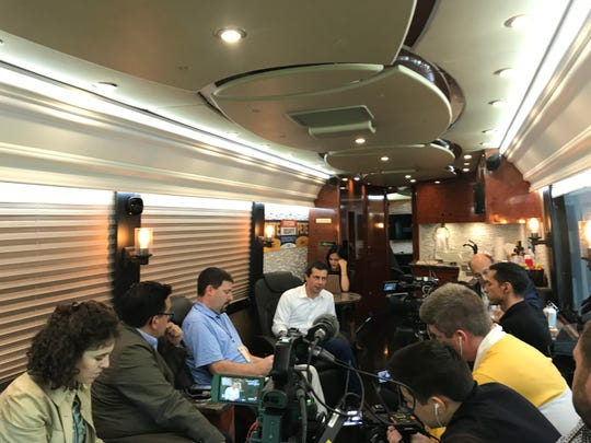 Democratic presidential candidate Pete Buttigieg answers questions from the press on his campaign bus in Iowa on Sunday, Sept. 22, 2019.