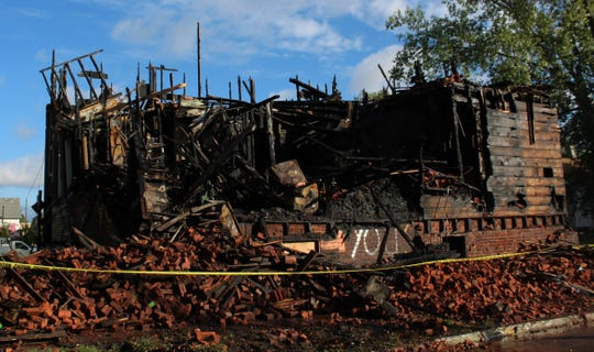 The burned backside of the house.