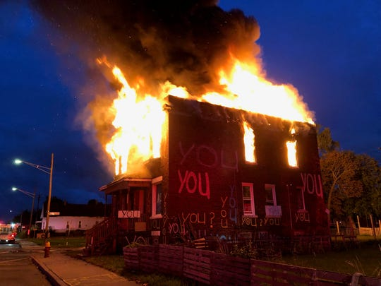 A fire blazes at a Heidelberg Project building early Sept. 23, 2019.  Investigators have one person in custody in connection with the suspected arson.