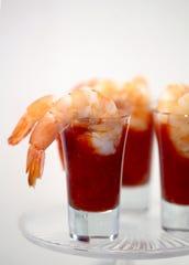 Shrimp cocktail served in shot glasses.